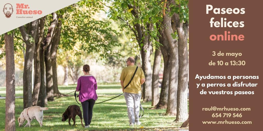 Cartel con los datos de la formación, aparecen dos personas con sus perros andando entre árboles